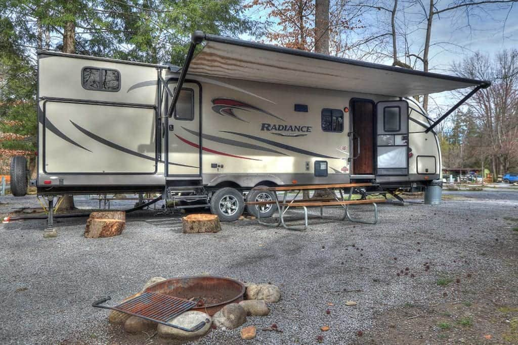 rv rental with firepit and picnic table at a smoky mountain campground
